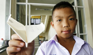Mong Thongdee who ranked top of the paper airplane competition in Thailand
