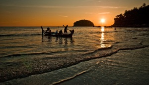 Long tail boat at sunset Kata Beach Phuket Thailand